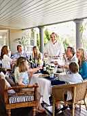 A family celebration on a covered terrace