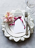 A table setting decorated flowers