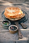 Crispy unleavened bread with tapenade and spinach paste