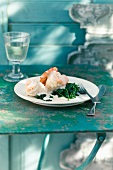 Sole fillets with white wine sauce and spinach