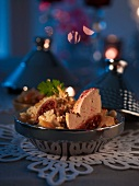 Goose liver tagine with bulgur and dried fruits