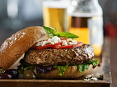 Pesto Turkey Burger with Feta Cheese, Tomato, Lettuce and Olives; With Beer