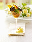 Chocolate Macaroons with Sliced Mango and Liqueur in a Martini Glass