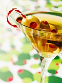 Martini with Olives Skewered on a Candy Cane Swizzle Stick