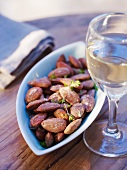 Roasted almonds and a glass of white wine
