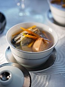 Broth with oysters and goose liver