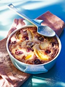 Clafouti with apricots, cherries and plums