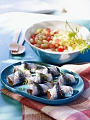Sardine rolls with a bean and tomato salad