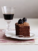 A slice of chocolate cake with prunes