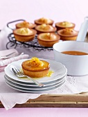 Friands (Australian almond cakes) with orange sauce