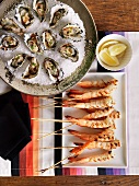 Prawns on skewers and oysters with balsamic vinegar