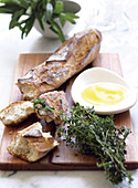 A baguette topped with olive oil and thyme