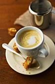 Caffè macchiato e cantucci (espresso, milk foam and biscuits)