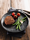 Beef steak with green beans and tomatoes