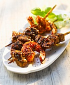 Grilled beef and prawn kebabs