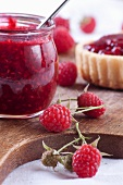Raspberry jam and a tartlet (close-up)