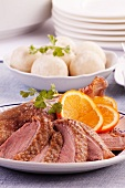 Roast goose with dumplings and oranges