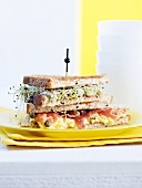 A beansprout, ham and scrambled egg club sandwich
