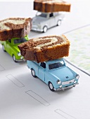 Slices of marble cake on toy cars