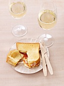 Croque monsieur with chorizo and two glasses of white wine