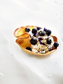 Pastry shell with ricotta, blueberries and poppy seeds
