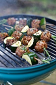 Kebabs with meatballs and zucchini on the grill