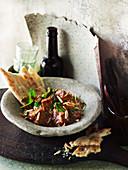 Afghanisches Lammcurry mit Spinat und Mandeln