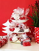 Christmas sweets in cellophane bags on a cake stand