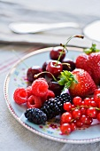 Fresh berries and cherries on a plate