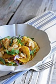 Pumpkin ravioli with fresh herbs and butter sauce
