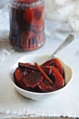 Spiced plums in red wine