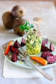 Baked beetroot and carrots with an egg and caper salad