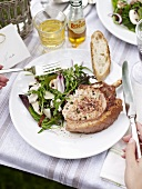 Grilled pork chop filled with herb cream cheese
