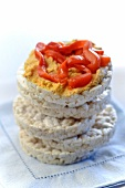 Stack of Rice Cakes with Top Cap Topped with Hummus and Roasted Red Peppers