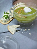 Broccoli soup and crackers with blue cheese