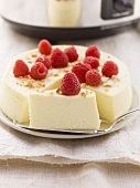 Slow cooker cheesecake with fresh raspberries
