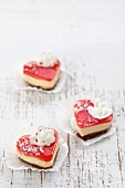 Three heart-shaped cakes with a cream filling and a red jelly topping