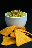 Bowl of Homemade Guacamole; Tortilla Chips