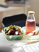 Beetroot salad with croutons and a bottle of juice for lunch