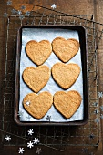 Heart-shaped cinnamon biscuits on a baking tray