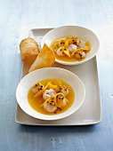 Cold pineapple and passion fruit soup with lychees