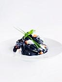 Black tagliatelle with a dollop of white foam