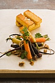Sauteed carrots with slices of polenta