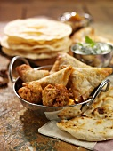Samosas (fried pastries, India) and flat bread