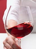 A glass of red wine with 'tears' (sign of of alcohol content)