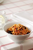 Spaghetti alla puttanesca (spaghetti with tomatoes, anchovies and olives)