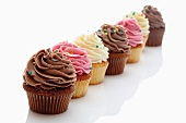 Several cupcakes with buttercream (strawberry, vanilla, chocolate)