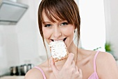 A woman eating crispbread with butter