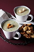Cream of potato and spinach soup with croutons