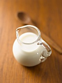 A jug of milk on a wooden table